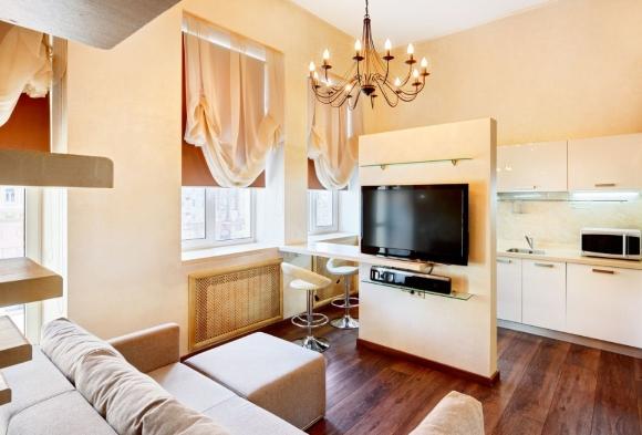 Гипсокартонная перегородка между кухней и гостинной с телевизором