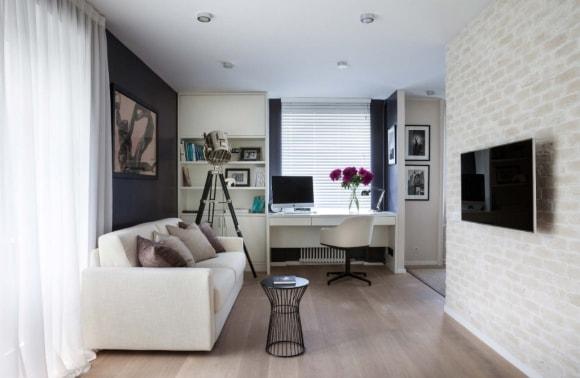 Двухкомнатная квартира с кирпичной стеной в стиле лофт